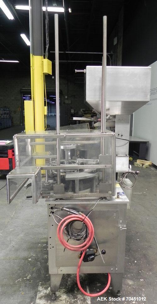 "Used- Haumiller model 3400 Stainless Steel (6) Pocket Spray Tip Applicator. Single Hammer, 16"" vibratory feeder bowl. Approx..."