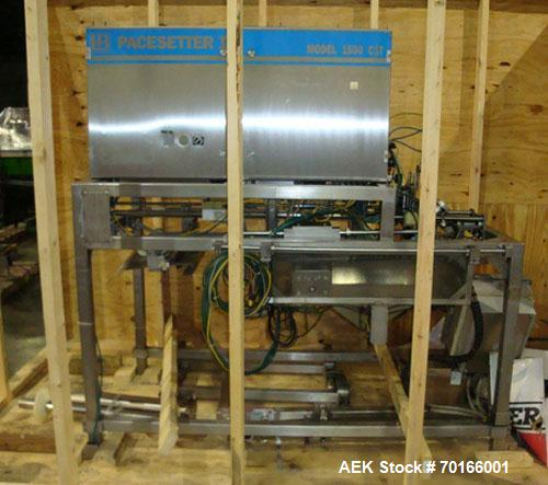 Used-Liquibox Model 1500C1T-W High Speed Strip-Fed Bag Filler. Machine has OxEvac system designed to fill one to five gallon...