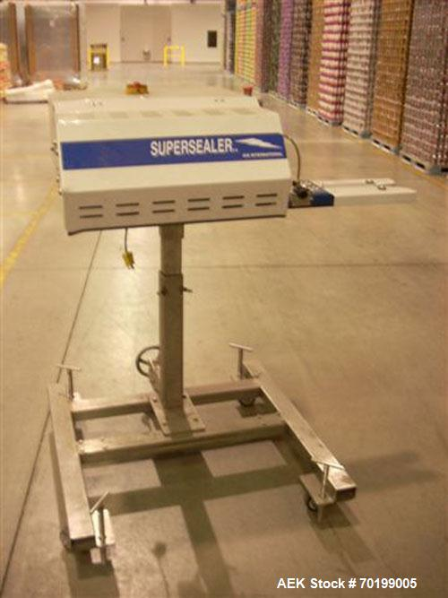Used-OK International SSI Hot Air Continuous Motion Bag Sealer capable of speeds up to 75 feet per minute. 1/60/110V, 15 amp...