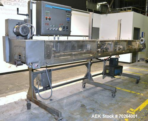 Used- Doboy GS1000 double fold glue sealer capable of speeds up to 85 feet per minute. High Speed Heat Sealer for paper bags...
