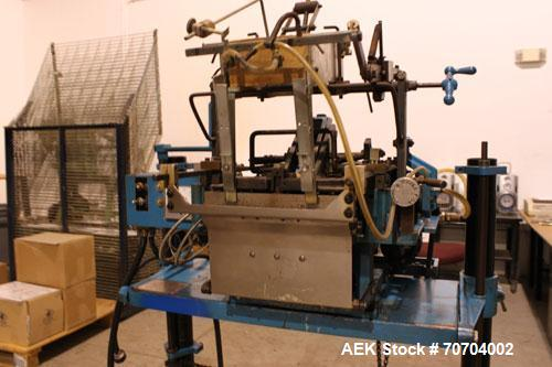 "Used-Doboy Bag Top Labeler, Model JSL.  Seals, folds and labels up to 40 bags per minute.  Seal width 1/2"" (3.81 cm).  Label..."