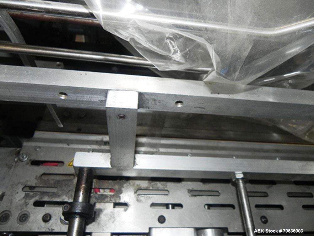 "Used-Rennco Dual 501 Vertical L-Bar Sealer with model CCL (cup counter loader). Horizontal seal approximately 36"" wide, vert..."
