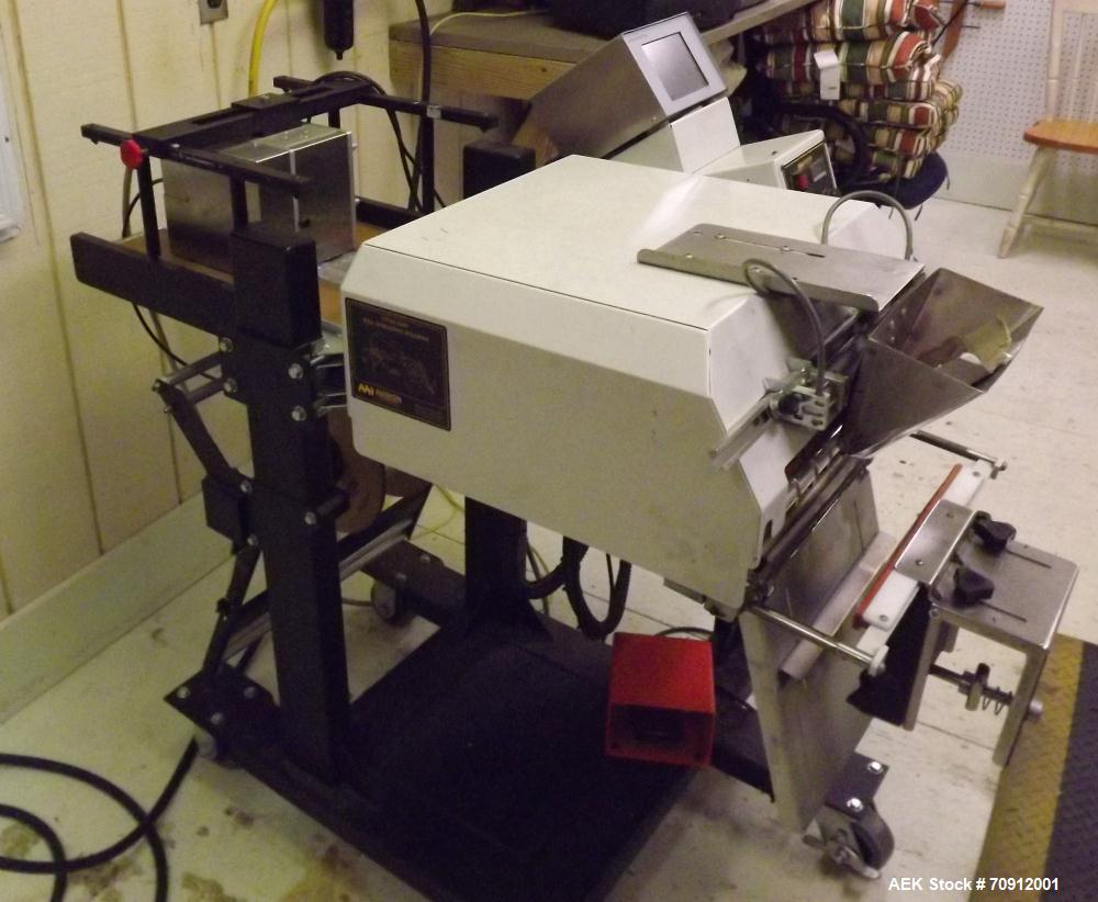 "Used-Titan Automatic Bagger and Sealer, Model 6500 Rollbag.  Min bag size 2"" x 2"", max bag size 10"" x 12"", 60 bags/min, full..."