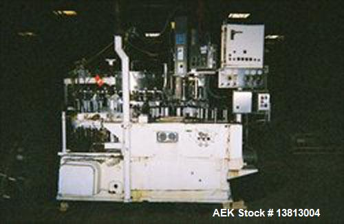Used-Crown 45 Valve Filler, Model 45-6. With 6 head cap-in-head capper. 3.0L pitch machine. Includes Alcoa 6 head capper con...