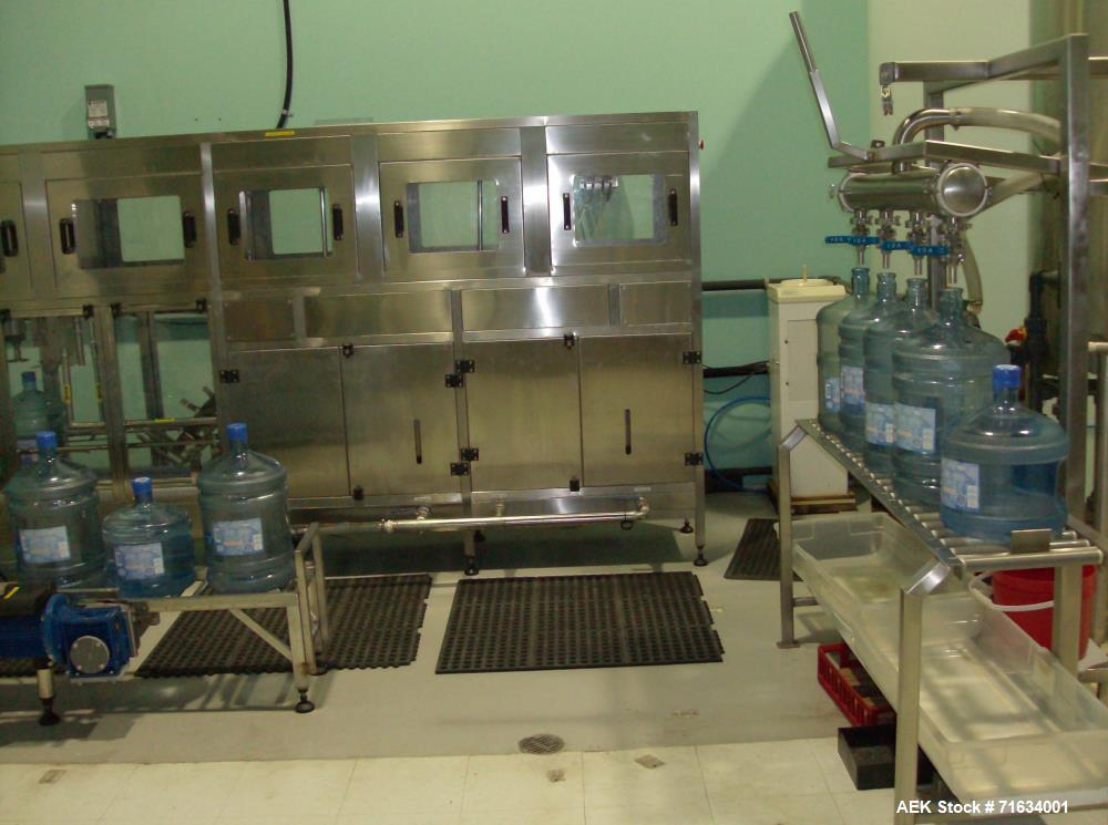 Used- Water Bottling Plant, 18.9L, 11L, and 4L Bottles. Plant consists of: 1 x 4 bottle filler with conveyor. (1) bottle wat...