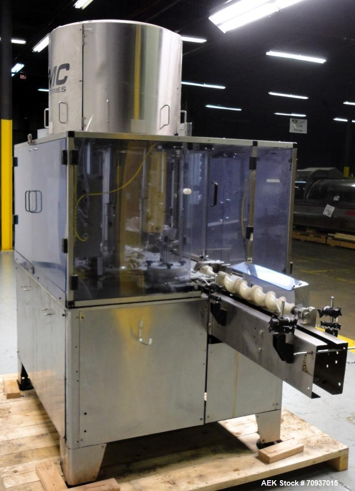Used- PMC Model XRI-8000 Rotary Pump Crimper. Capable of speeds up to 120 per minute. Minimum height of container in puck 4-...