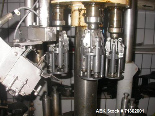 Used- Alcoa 4 Head Capper. Used for MCA 28 and Stelvin 30/60 caps. Has change parts for 31.5 mm. Last used on wine bottles. ...