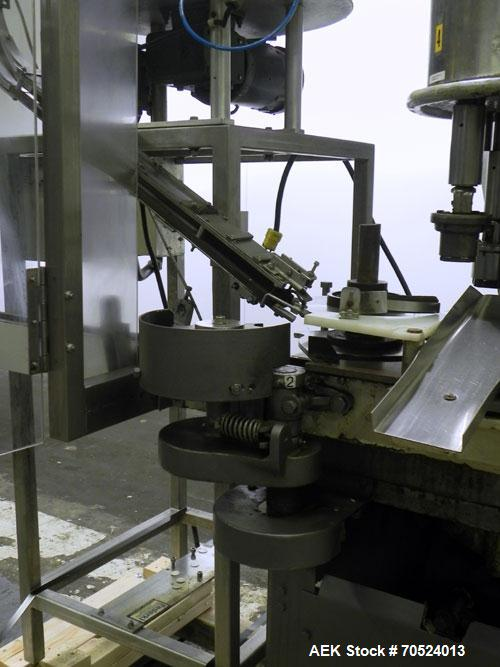 Used- Consolidated Capem C4F Rotary Chuck Capper
