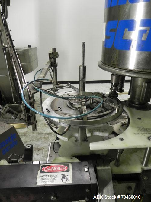 Used- Consolidated Rotary Chuck Capper, Model D4FA