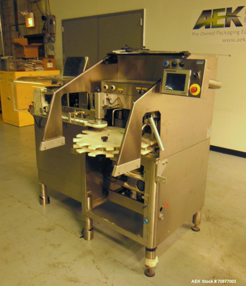 Used- Kalish (IMA) Starcap Model 5123 Single Head Chuck Capper. Machine is capable of speeds up to 90 bottles per minute. Co...
