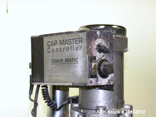 Used- Swanmatic Cap Master Single Cycle Bench Top Capper, Model C300. Up to 40 caps per minute. Driven by a 1/4 hp, 90 volt,...