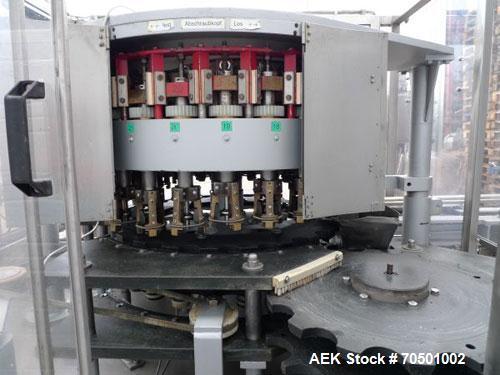 Used-Datz Decapper, 24 stations, 300 cm long x 250 cm wide x 220 cm high.