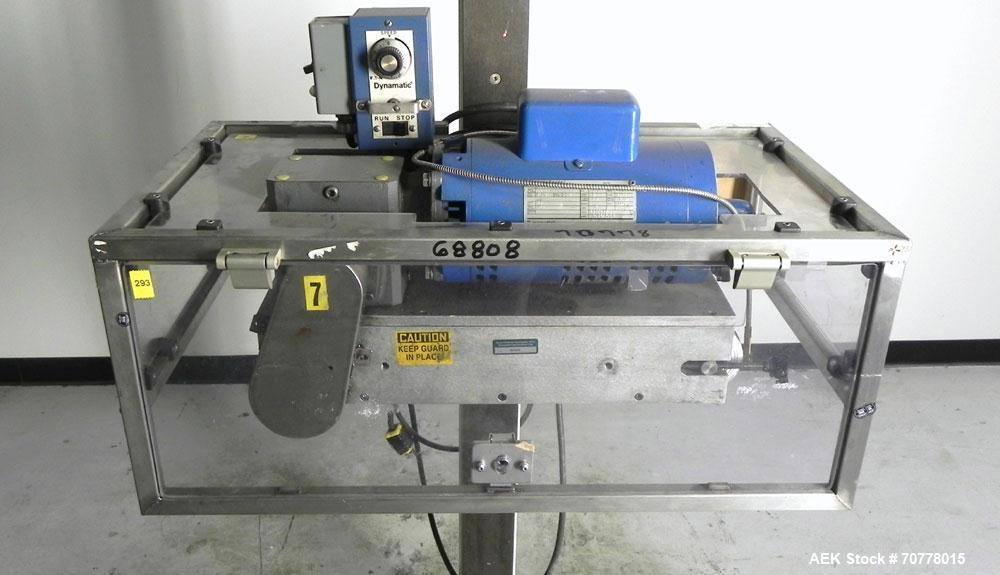 Used- Eaton Dynamics overcapper belt capper.