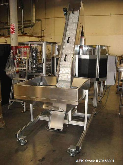 Used-Haumiller 4200 Series Overcapper capable of speeds up to 180 cans per minute. Includes cap elevator and sorter. New in ...