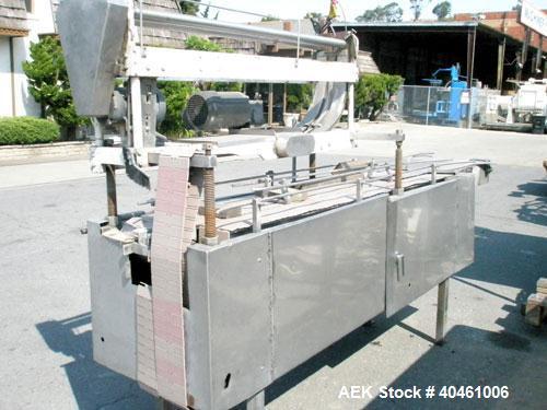 Used- 502size McKenna Can Over Capper/Lidder, model 700