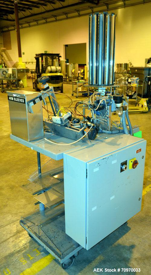 Used- Smith ET Dose Cup Applicator