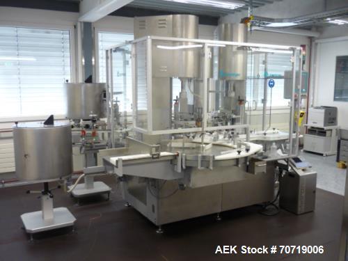 Used- Groninger MCS301R, Crimp Capper. Maximum 3000 vials/h, stainless steel (1.4301) construction, 230/400V, 50 Hz. Includi...