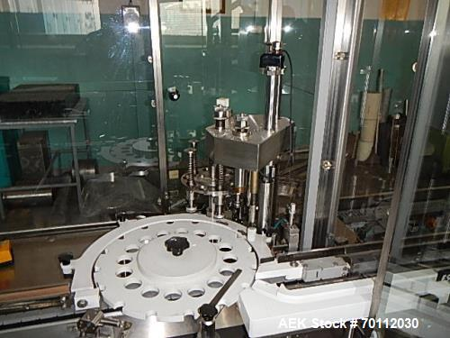 Used- IMA Automatic Screw Capper, Model F97/VD5. Automatic feeding and placing of caps onto bottles. Welded steel frame with...