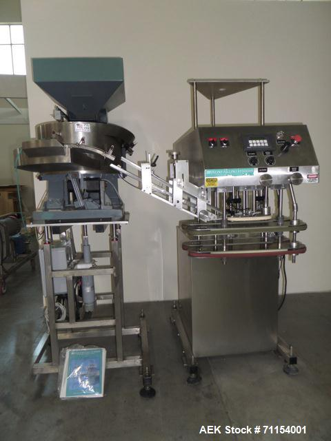 Used- Inline Filling Systems Capper.  110V, 60 cycle.  Includes hopper and quality feeder Model 21CCW.  Manufactured 2002.