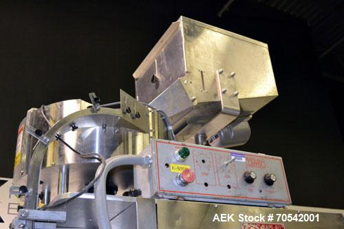 Used- Kapsall Model A Inline Screw Capper. Capable of speeds up to 200 bottles per minute. Has dual bottle grippers, three p...