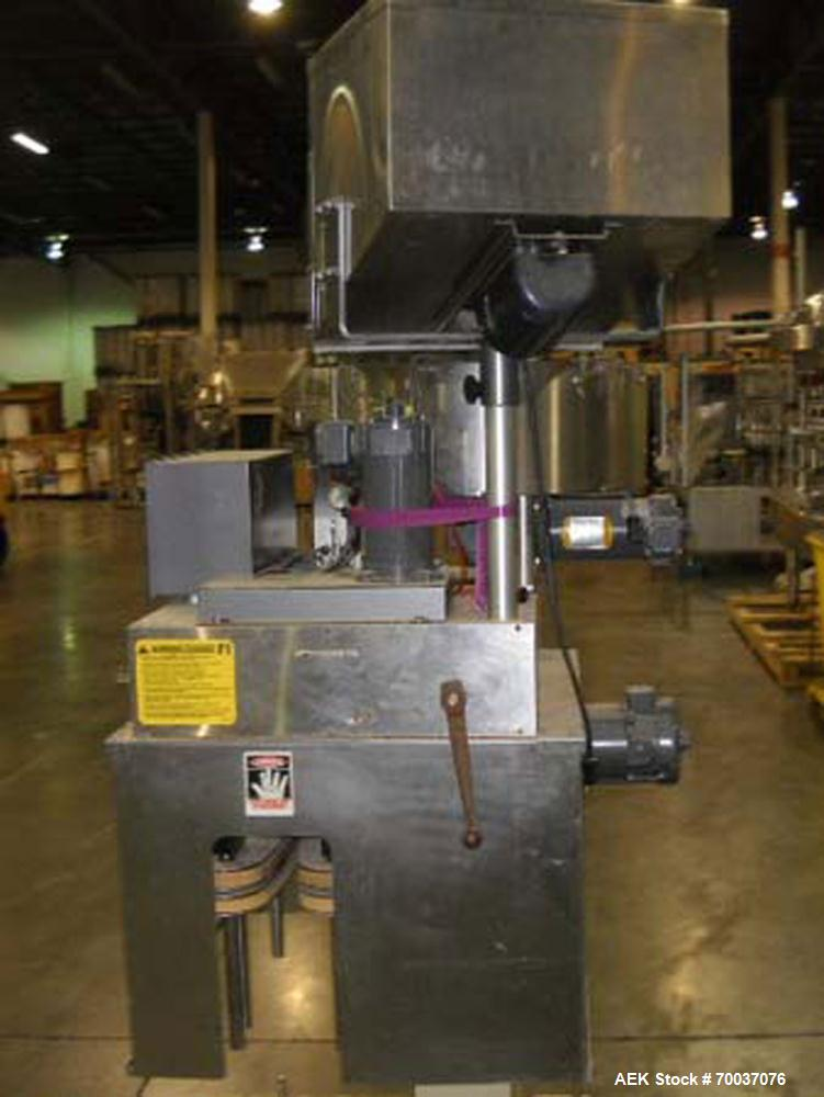 Used- Kaps-All E4 automatic inline quill capper. Capable of speeds up to 80 bottles per minute. Has dual side belt grippers....