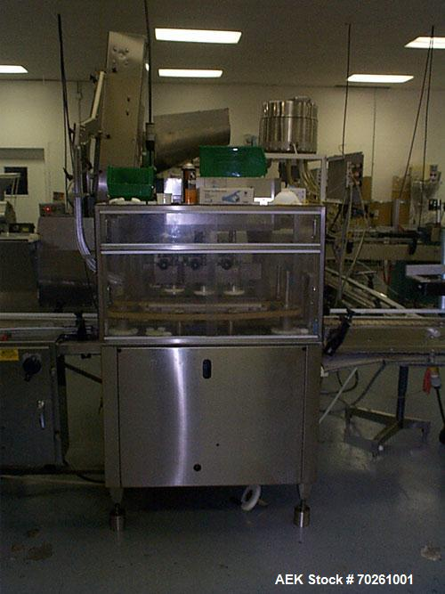Used- Mar Quill Capper capable of speeds up to 150 cpm. Has incline cleated belt elevator hopper for cap feeding. Single bel...