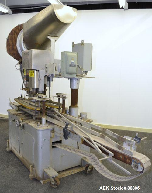 Used- Resina Model U-30 Inline Quill Style Capper. Manufacturer rates at up to approximately 250 caps per minute on 13 mm to...