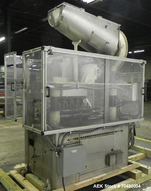 Used- Resina Model U40 Automatic Inline Quill Capper. Capable of speeds up to 250 containers per minute. Cap size range 13mm...