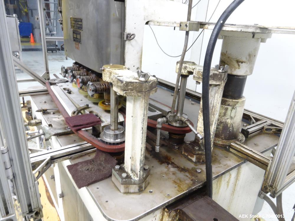 Used- Resina Model U40-206 Automatic Inline Capper