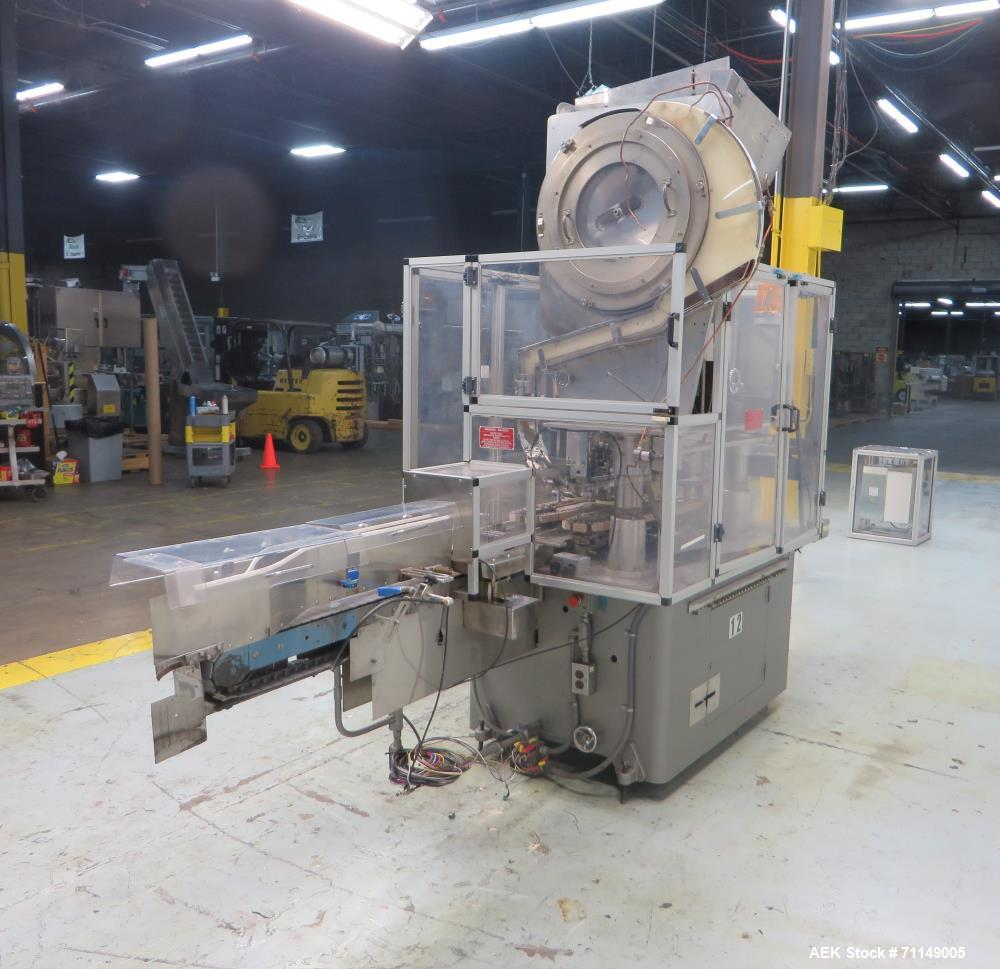 Used- Resina Model UN-40 Automatic Inline Quill Style Screw Capper