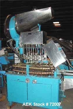Usedina model U-40 automatic screw capper, 4 quill straight conveyorized dual gripper. Approximate cap range: 13 to 38mm or ...