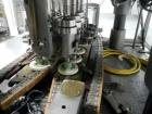 Used- Resina Model U40 Automatic Inline Capper. Machine is capable of speeds up to 300 caps per minute. Is a 4 station cappe...