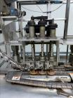 Used- Resina Model UN30 Automatic Inline Quill Screw Capper