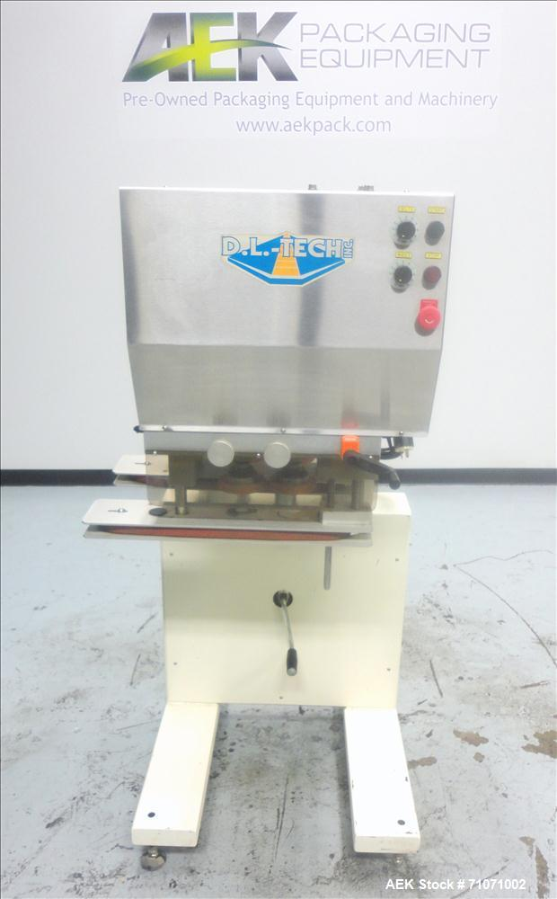 Used- D.L.Tech (Aesus) Model DLCAP-2E Cap Retorquer. Machine is capable of speeds from 0 - 120 containers per minute.  Singl...