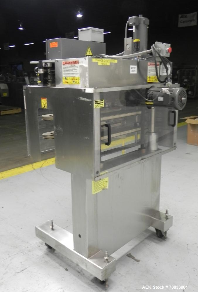 Used- Kaps-All Model FA6 Industrial 6-Spindle Cap Retorquer. Machine is capable of speeds from 20 to 200 bottles per minute....