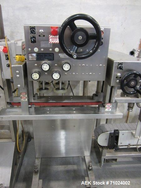 Used-Kiss Packaging Model CT-04 Automatic Cap Tightener/Retorquer. Capable of speeds over 100 containers per minute. Has an ...