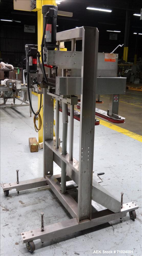 Used- Kiss Packaging Model VCT-04 Automatic Cap Tightener/Retorquer. Capable of speeds over 100 containers per minute. Has a...