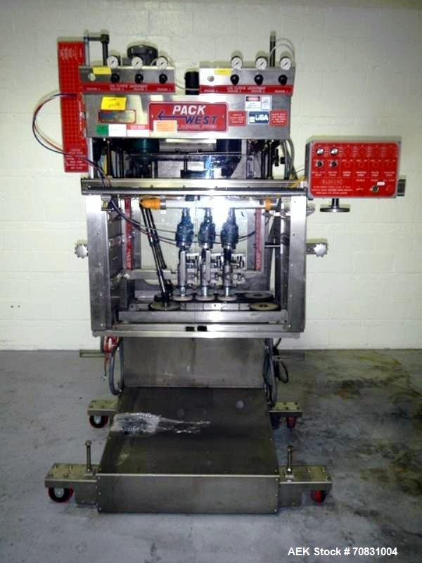 Used- Pack West Auto Model AC-120 Cap Tightener & Retorquer. Capable of speeds up to 150 containers per minute. Cap size ran...