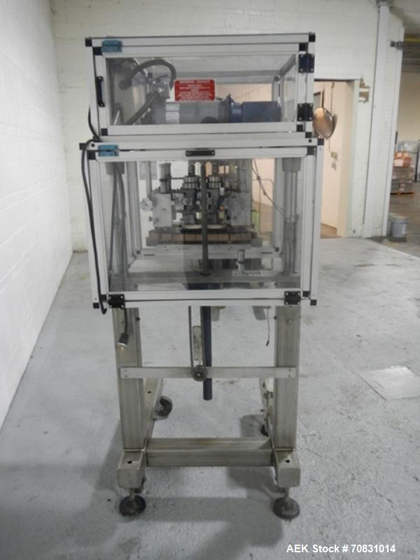 Used- Resina Model RT20-53 Cap Tightener Retorquer. Capable of speeds up to 90 bottles per minute. Cap size range: 13mm to 3...