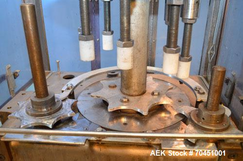 Used- Consolidated Capem Model C4HB 8 Head Rotary Cap Press with Star Wheel Infeed and Discharge.