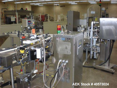 Used: Pillar water cooled induction sealer. Last used in pharmaceutical packaging operation.
