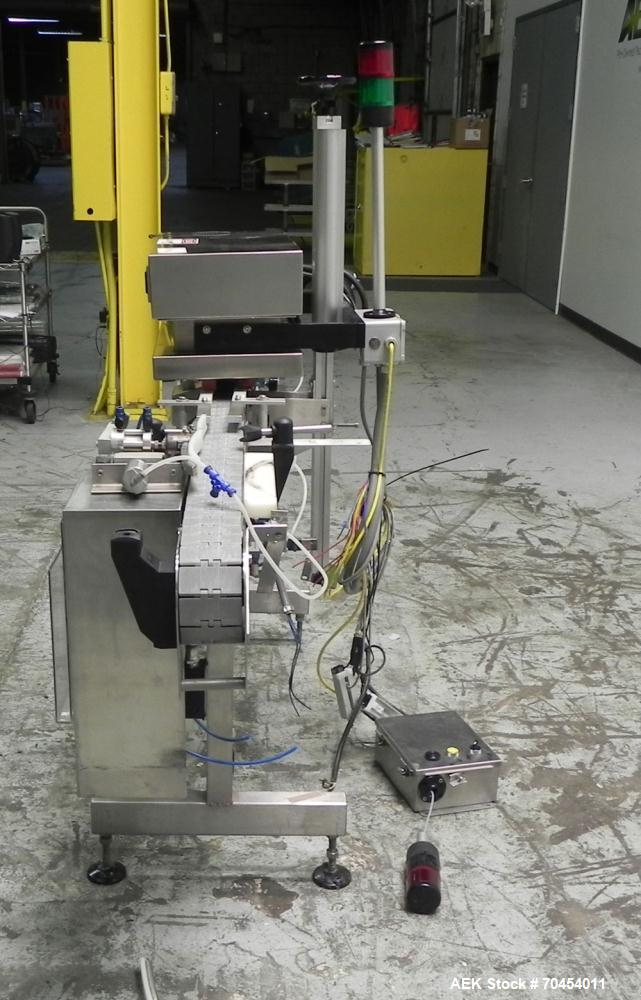 Used- Enercon Model Compak Induction Sealer. Unit is 2kW. Water cooled, includes water-cooling system. 15 amp. 1/60/230V.