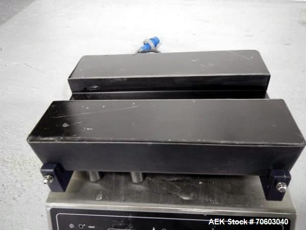 Used- Enercon induction sealer, model LM4481-03, serial# C17063-01.