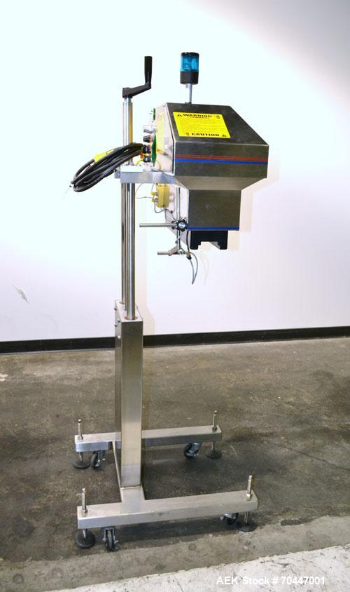 Used- Automate Technologies Cap Induction Sealer, Model AM-20. Equipped with tunnel style seal bar with stepped inside dimen...