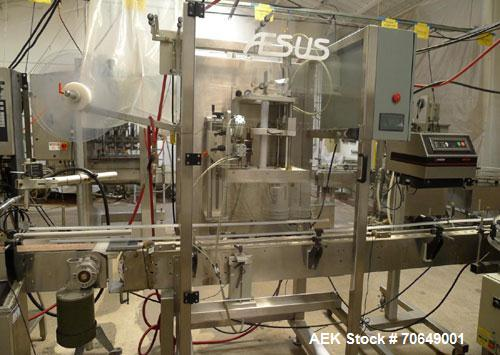 Used-Aesus Model 100 Neck Bander and Shrink Tunnel capable of speeds up to 100 bottles per minute. Tamper evident banding gl...