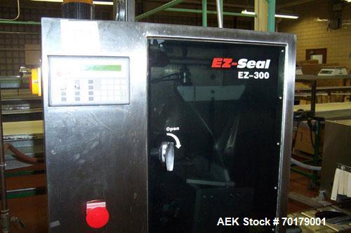 Used-Axon EZ300 Neck Band Applicator capable of speeds up to 70 packages per minute. Includes Axon Model EZ24BR heat shrink....
