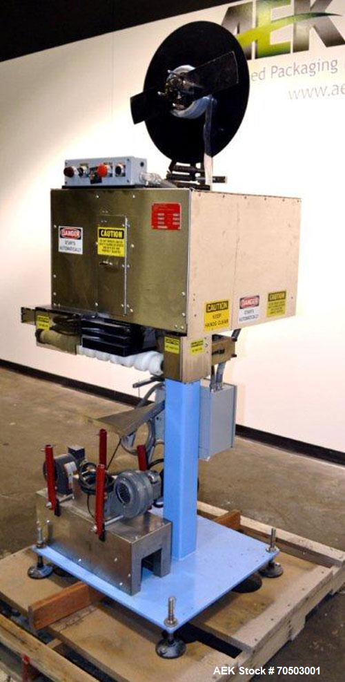 "Used- PDC Model 65M Tamper Evident Neck Banding Machine. Capable of speeds up to 200 bottles per minute. Band Diameter:3/8"" ..."