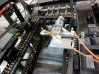 Used- Econocorp Spartan Automatic Horizontal Glue Cartoner capable of speeds up to 40 cartons per minute. Has 12