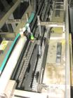 Used-Econocorp Spartan Automatic Horizontal Cartoner capable of speeds up to 40 cartons per minute. Has adjustable bucket in...