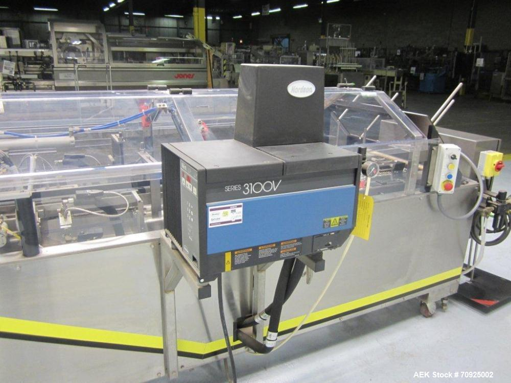 "Used-Econocorp Spartan Automatic Horizontal Glue Cartoner capable of speeds up to 30-50 cartons per minute. Has 12"" centers ..."